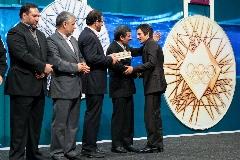 ماجرای اهدای اجباری مدال حمید سوریان به احمدی نژاد از زبان محمد بنا