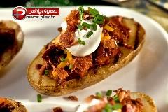 این پیش غذای جذاب را فقط در رستوران ها می توانستید پیدا کنید اما حالا... / آموزش تهیه سیب زمینی شکم پر به سبک فوق لاکچری
